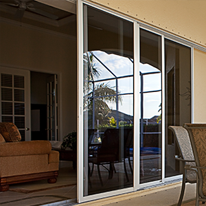 Open patio doors leading to large, sunny garden