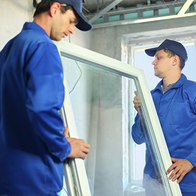 Fitters carrying window glass